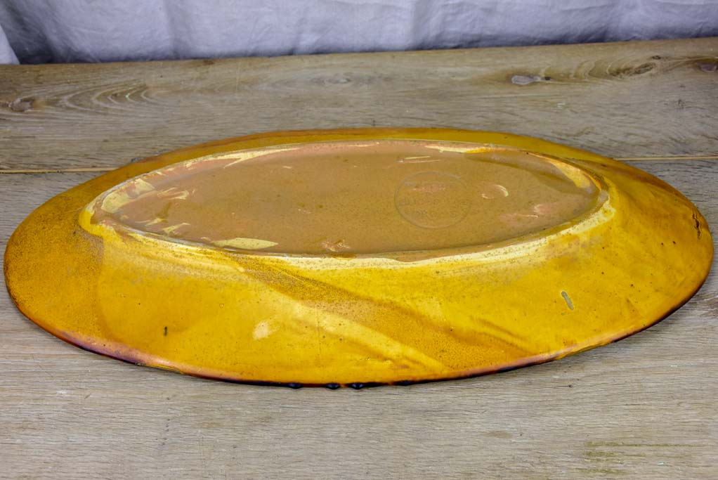 Very large ceramic platter with ochre glaze - Cliousclat Drome 1960's 26""