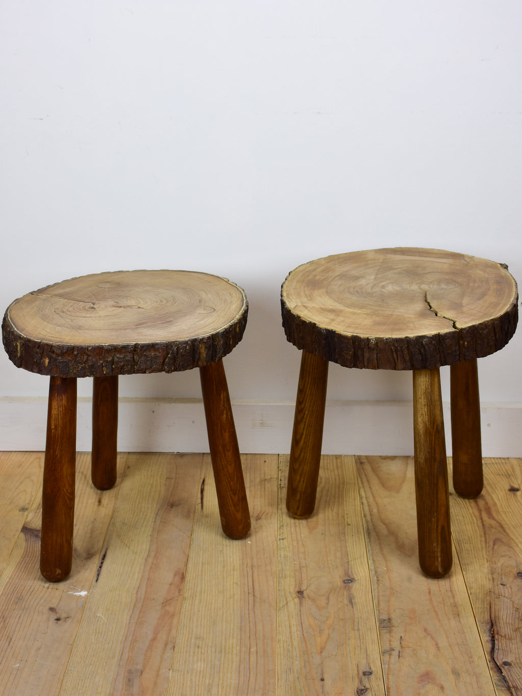 Two vintage French elmwood stools / side tables