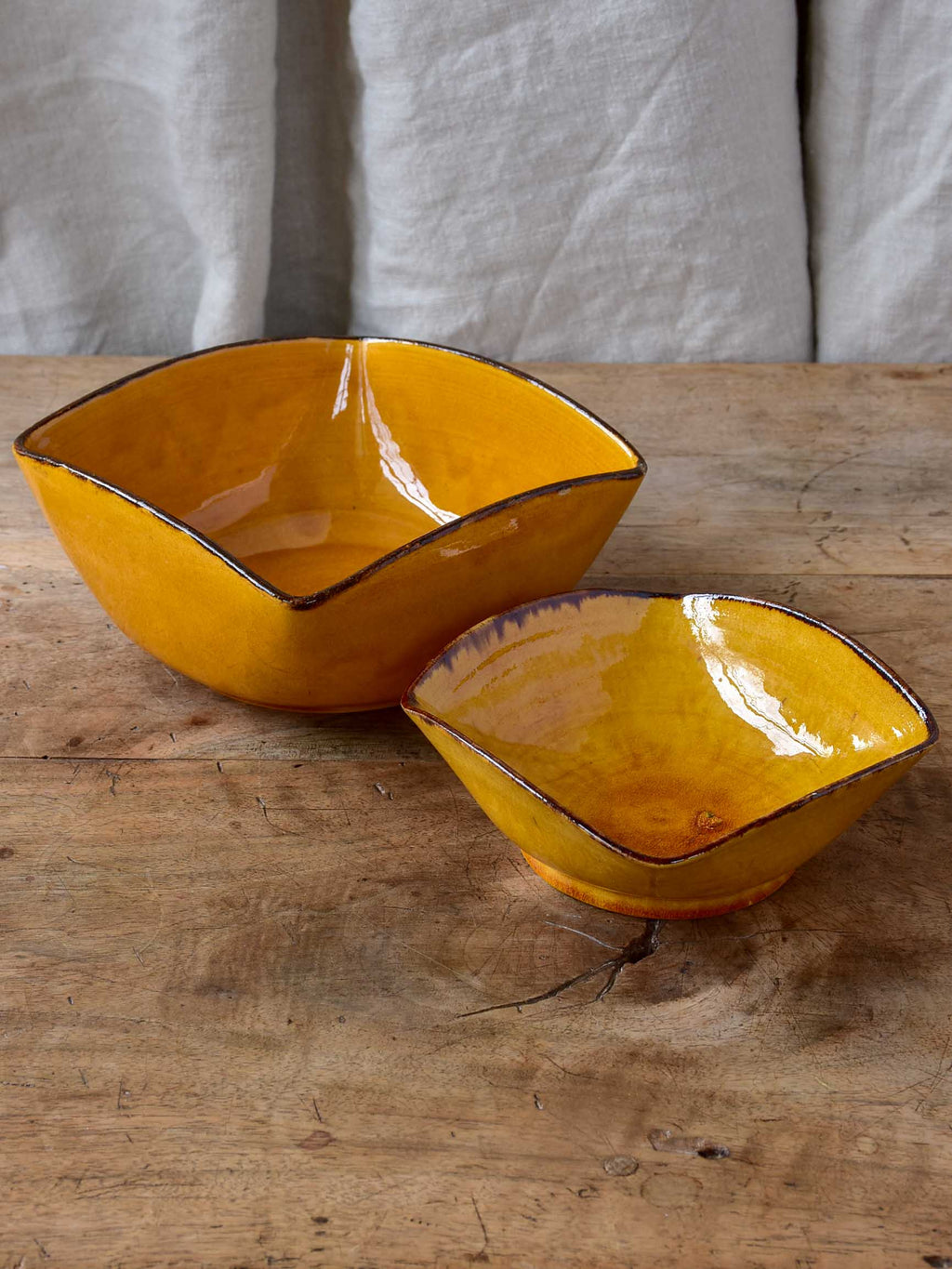 Two vintage Dieulefit bowls with ochre glaze