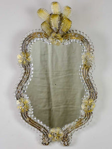 Vintage Venetian style mirror with gold leaves and flowers