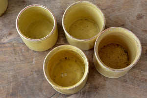 Collection of 7 antique French yellow ware pots
