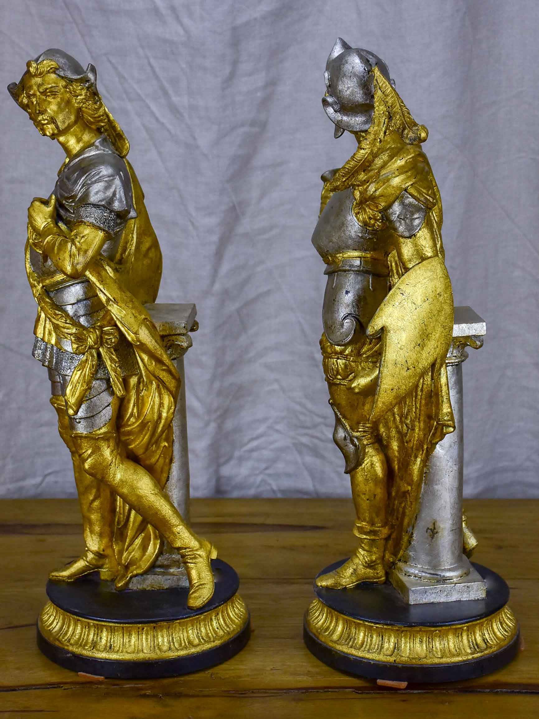 Pair of late 19th Century silver and gold statues