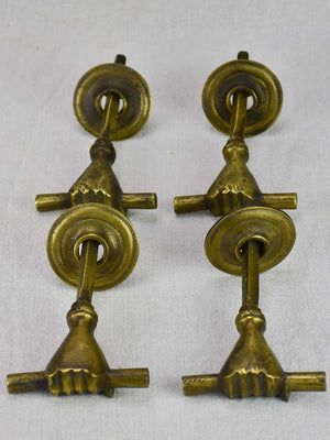 Four 19th Century english door handles in the shape of hands
