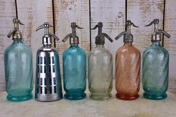 Collection of 12 antique French seltzer bottles