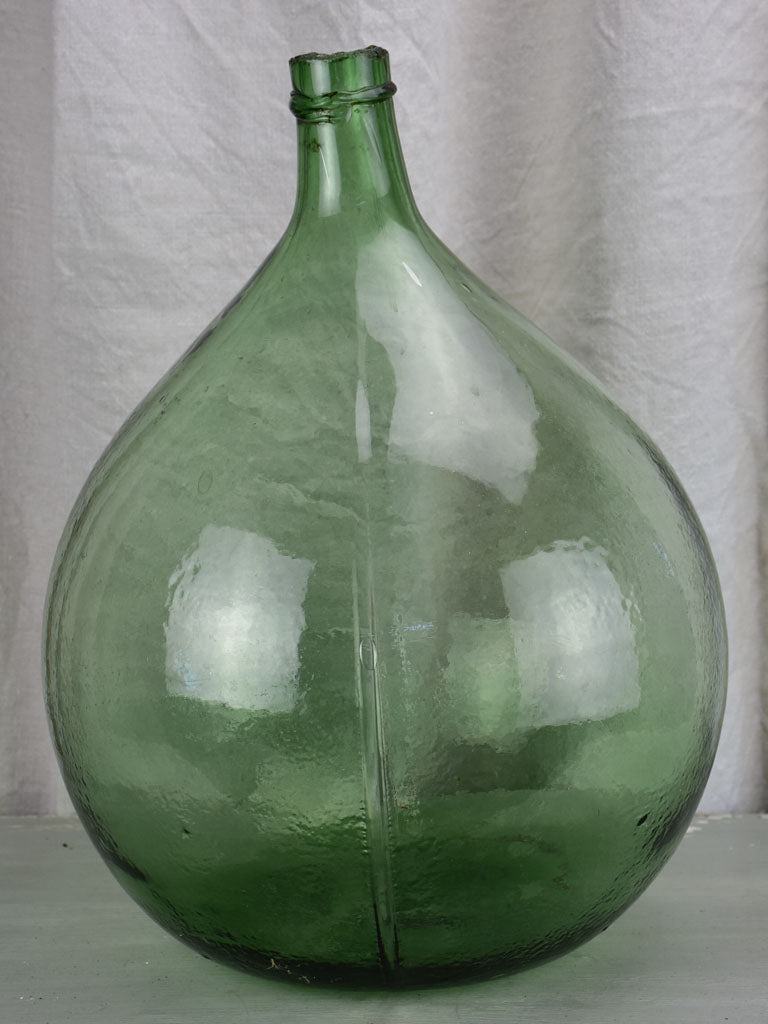 Large antique French demijohn - green