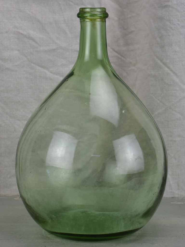 Small antique French demijohn bottle - green