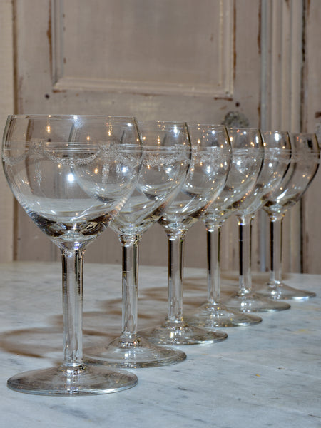 Six crystal wine glasses in the Louis XV style