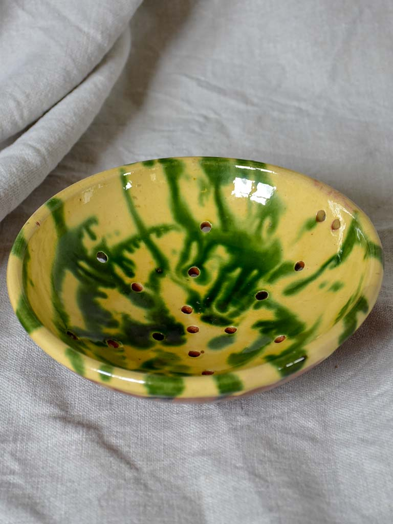 Vintage French strainer with green and yellow glaze