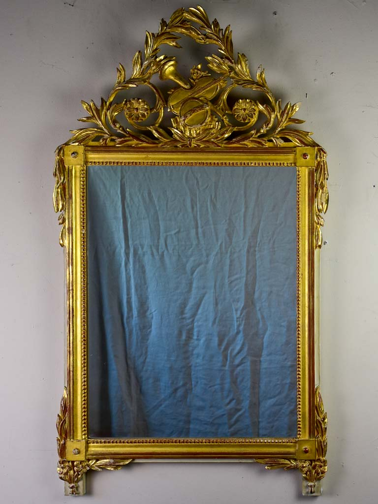 "Louis XVI style gilded mirror with musical floral crest and motifs 26½"" x 46¾"""
