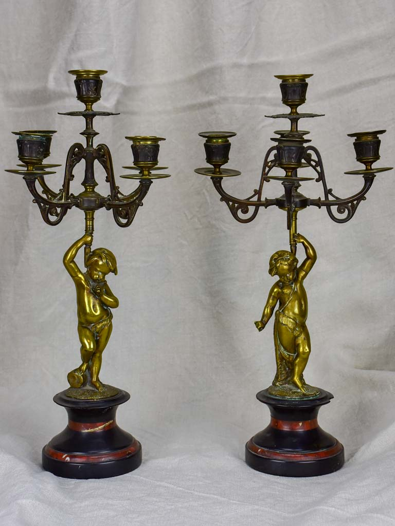 Pair of Napoleon III candlesticks with cherubs