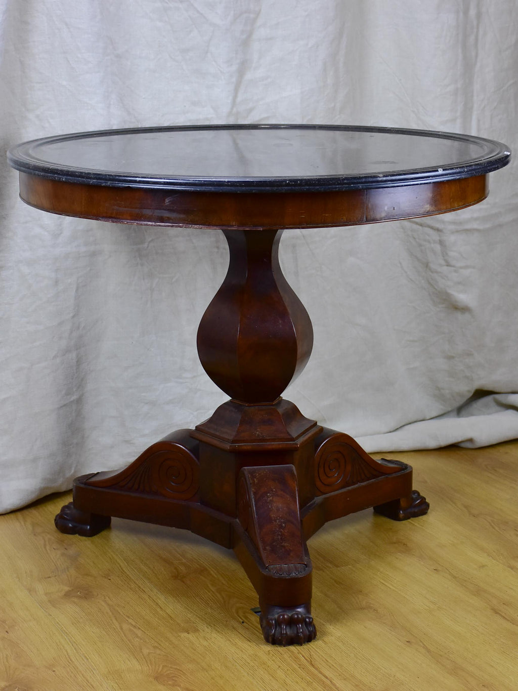 19th Century black marble top entry table with claw feet
