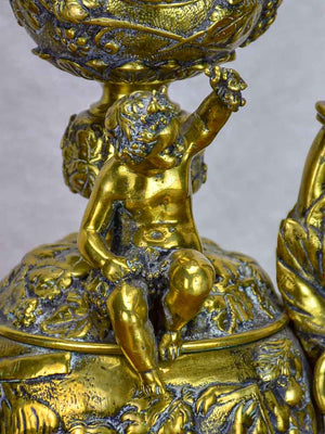 Bronze Napoleon III pitcher adorned with foliage, fruit and a cherub 17¾""