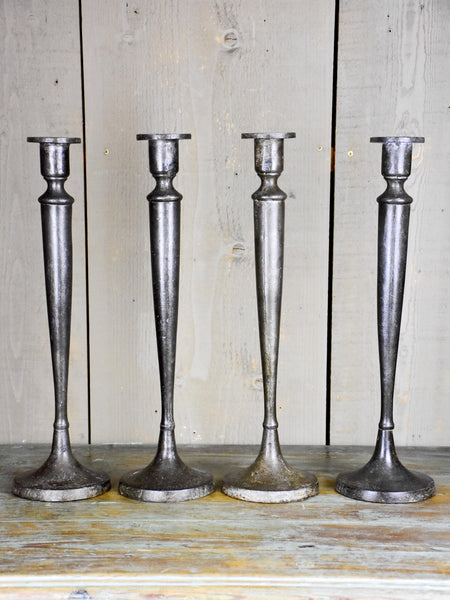 Set of four antique French candlesticks