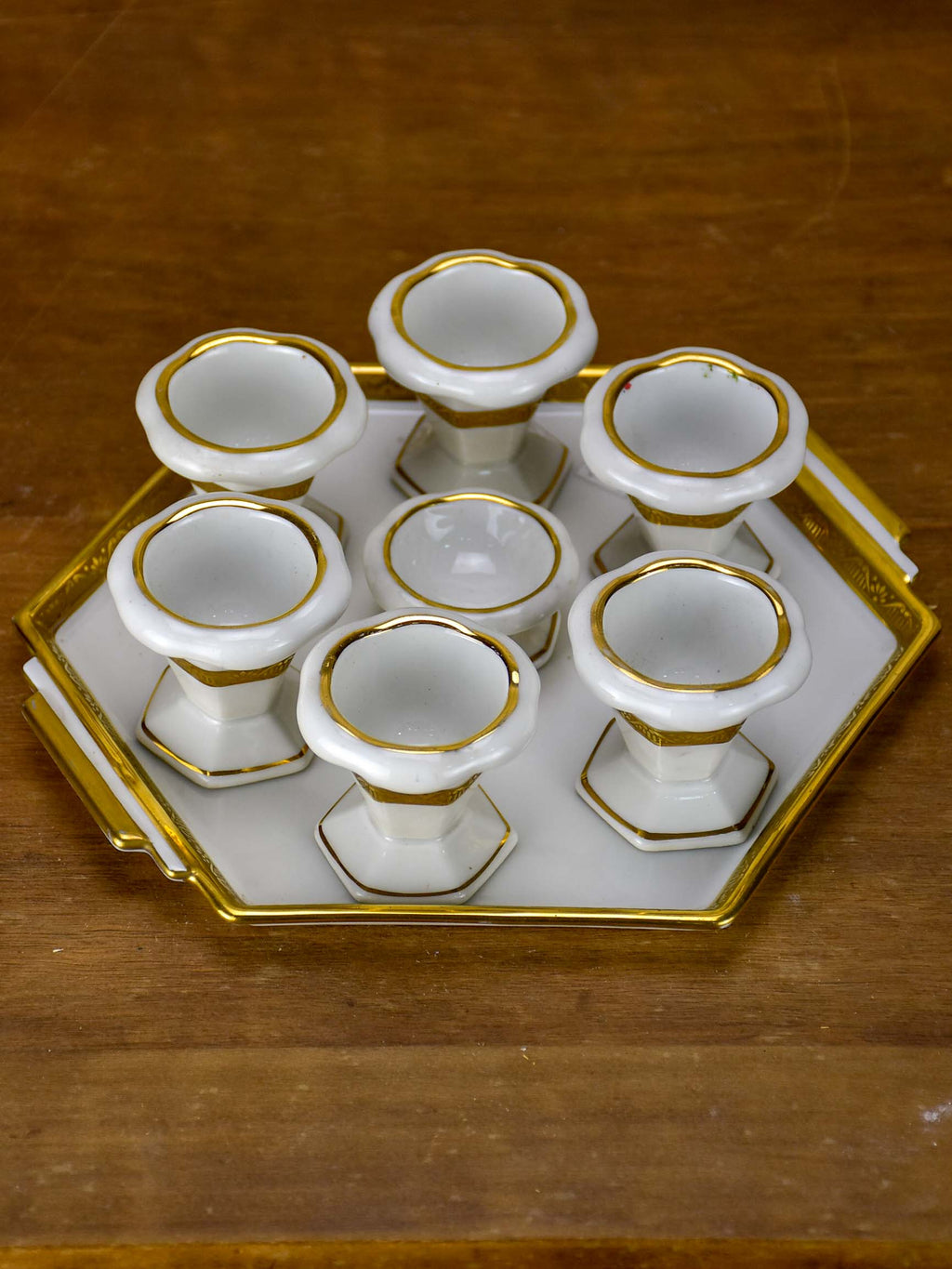 Antique French Limoges egg cups on a platter