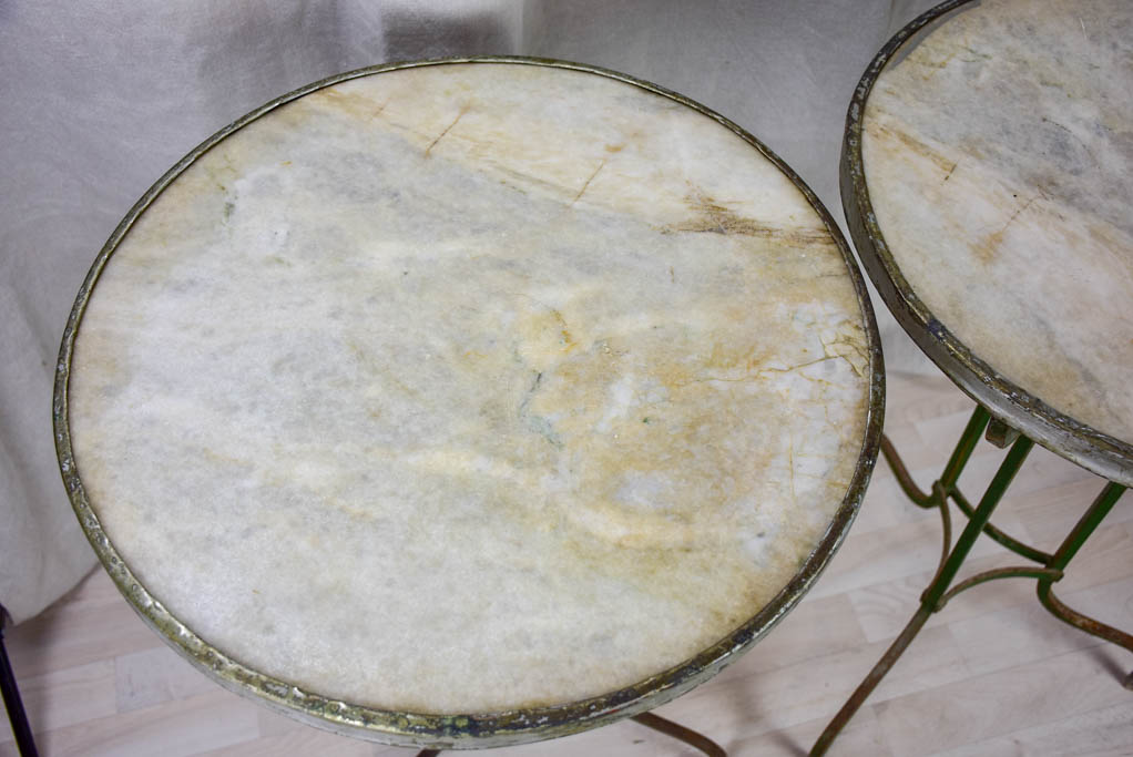 Pair of antique French marble top bistro tables