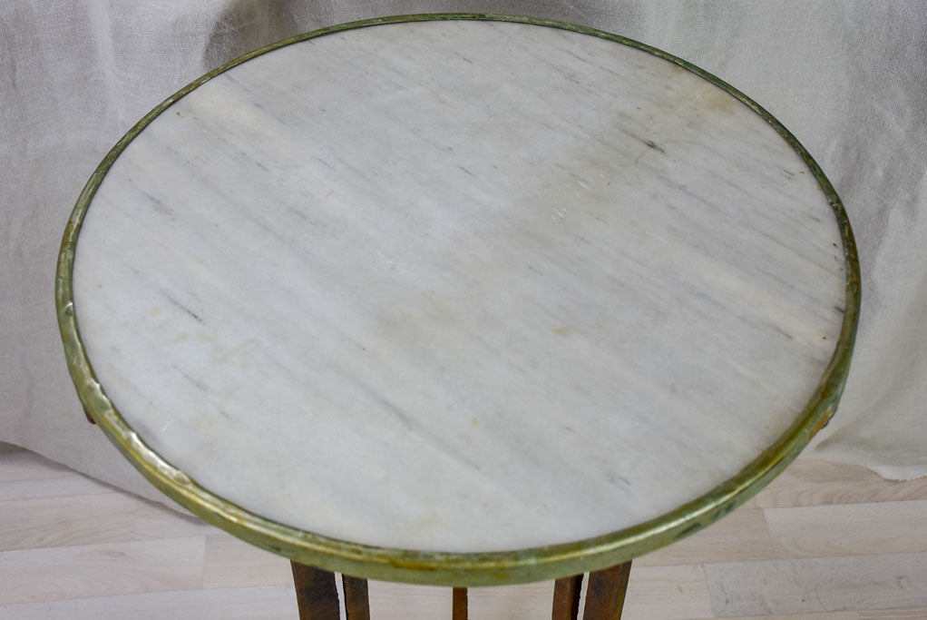 Antique French bistro table with marble top and cast iron base