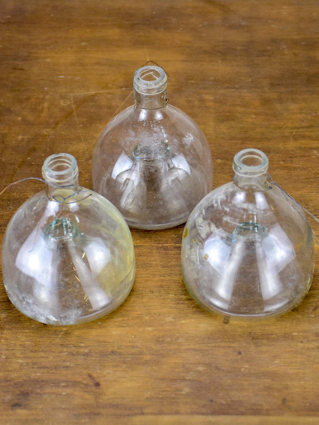 Three antique French fly-trap bottles