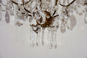 Set of four antique crystal wall sconces