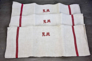 Three vintage French tea towels with large RM monogram