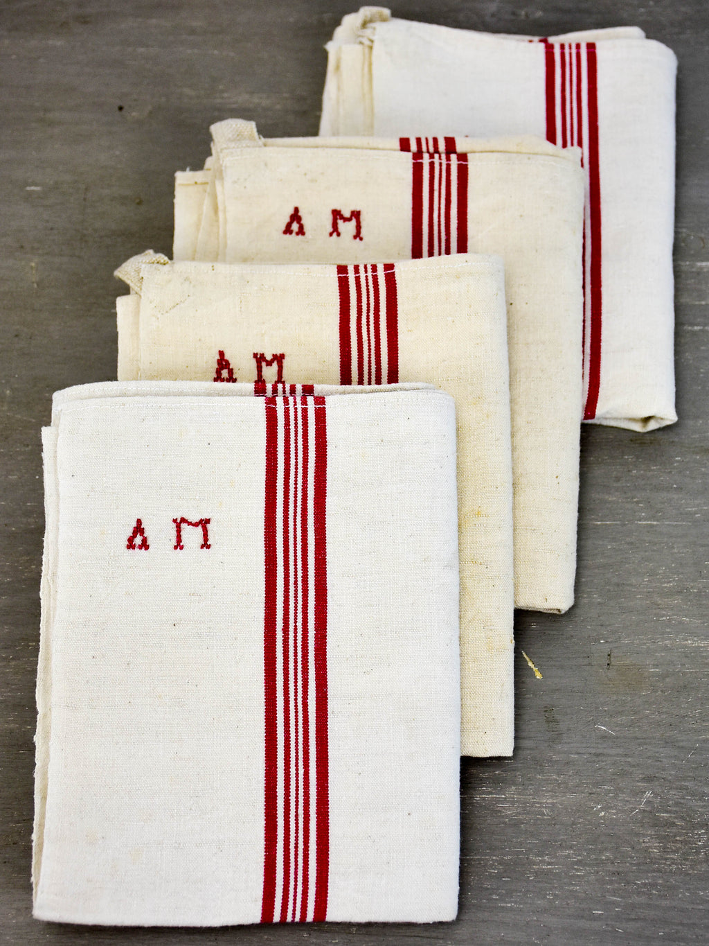 Four vintage French tea towels with AM monogram