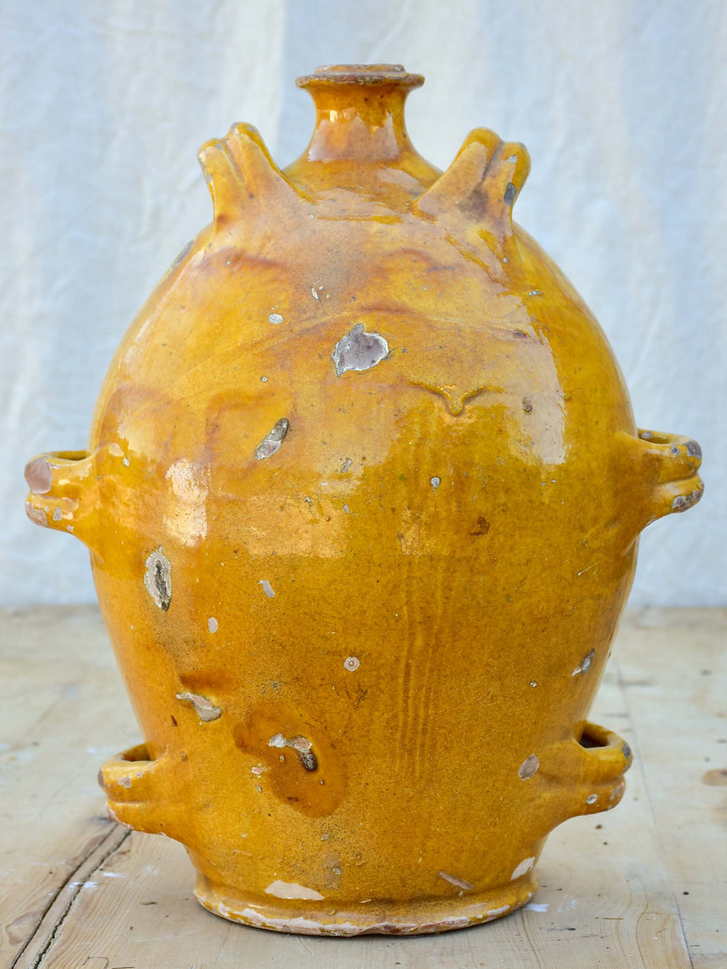 Antique French conscience water jug with yellow glaze