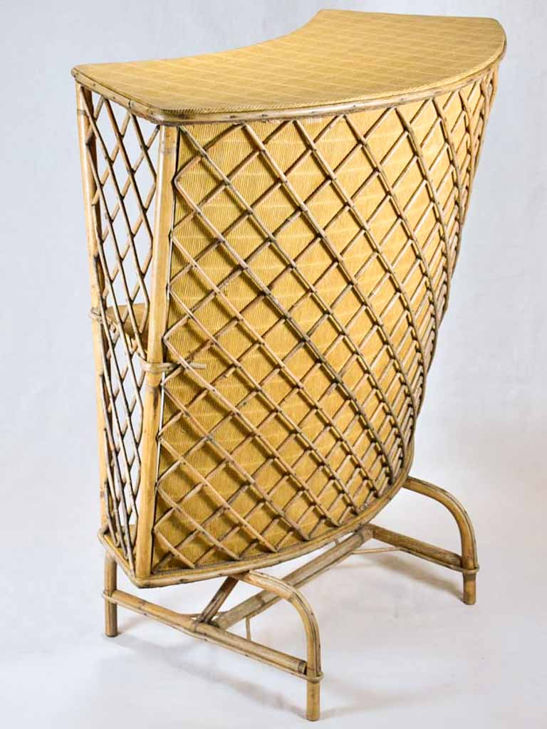 Mid-century curved rattan bar with lattice pattern