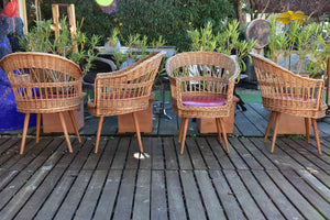 Four vintage French rattan armchairs