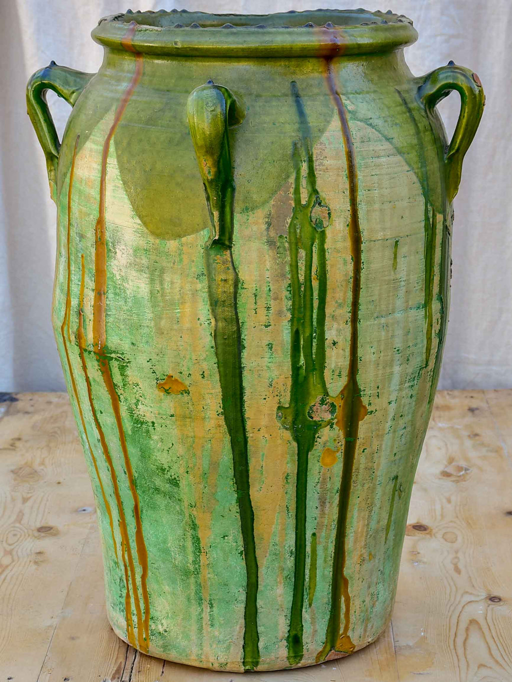 Large antique Spanish oil jar with green glaze