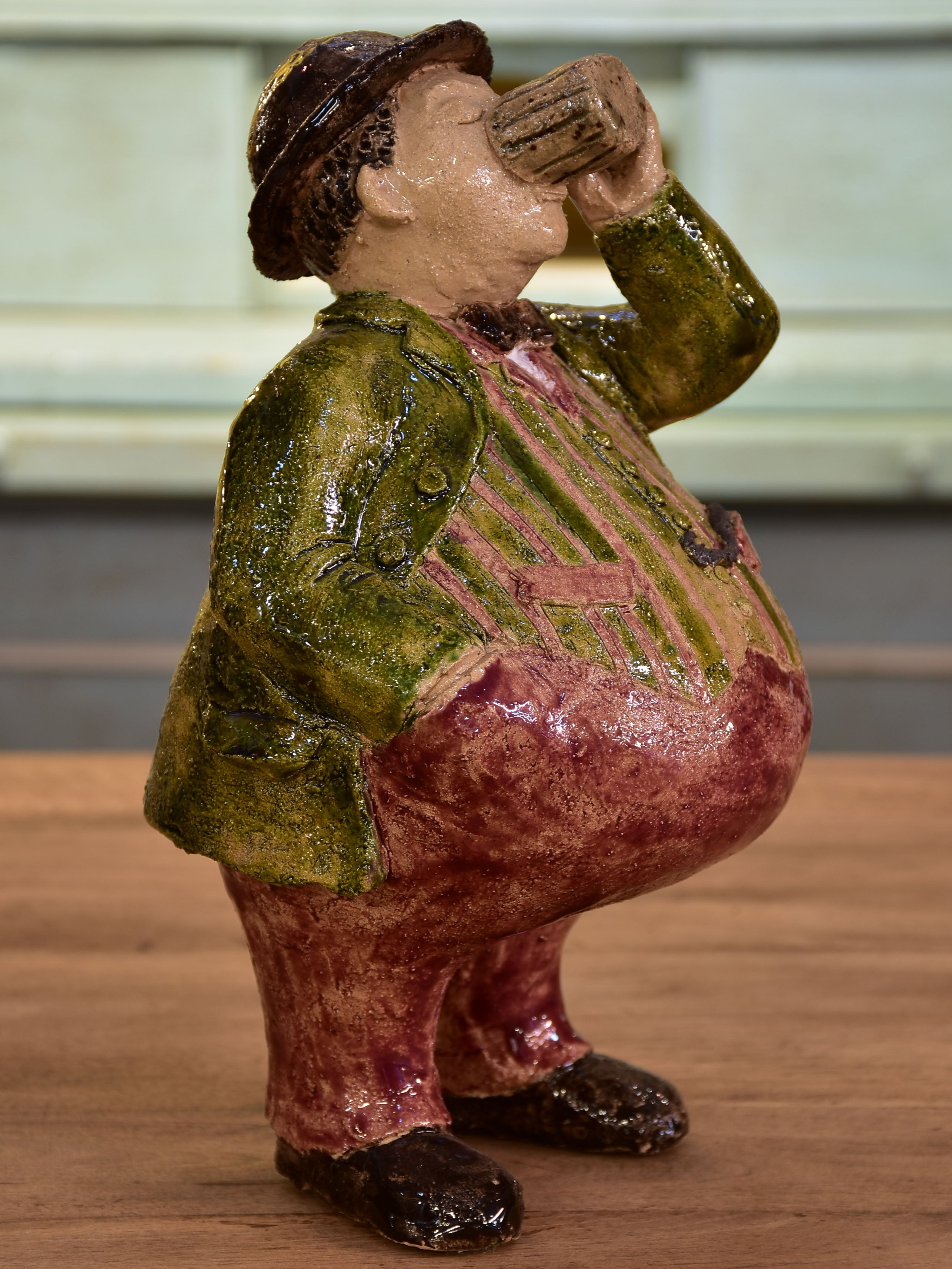 Artisan French sculpture of a man drinking beer