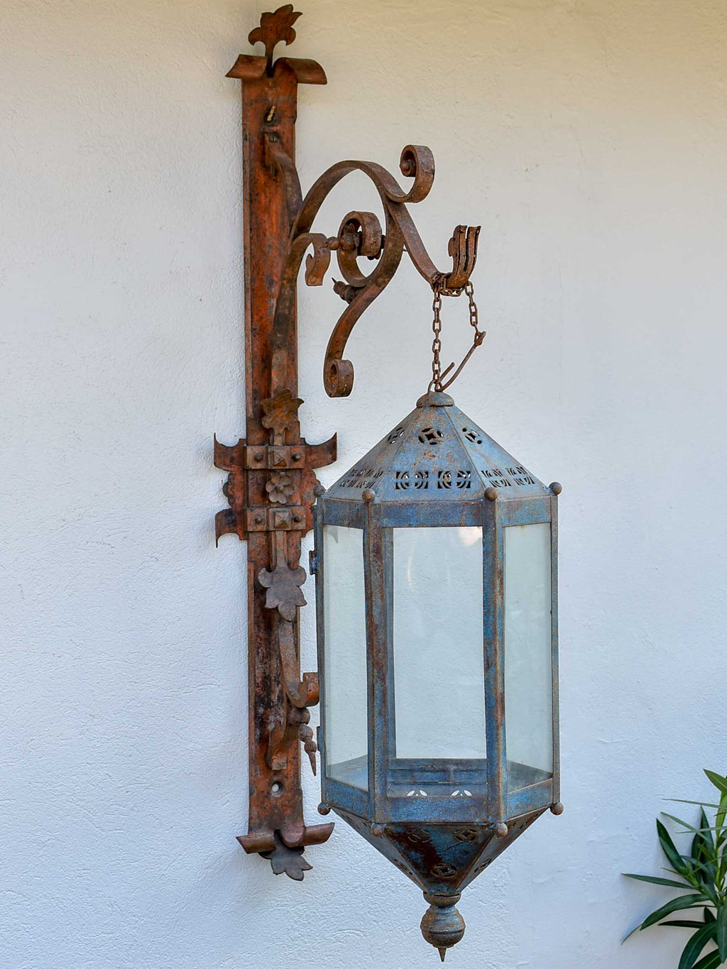Antique lantern with large wrought iron wall bracket