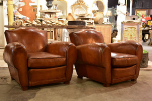 Pair of large moustache back French leather club chairs