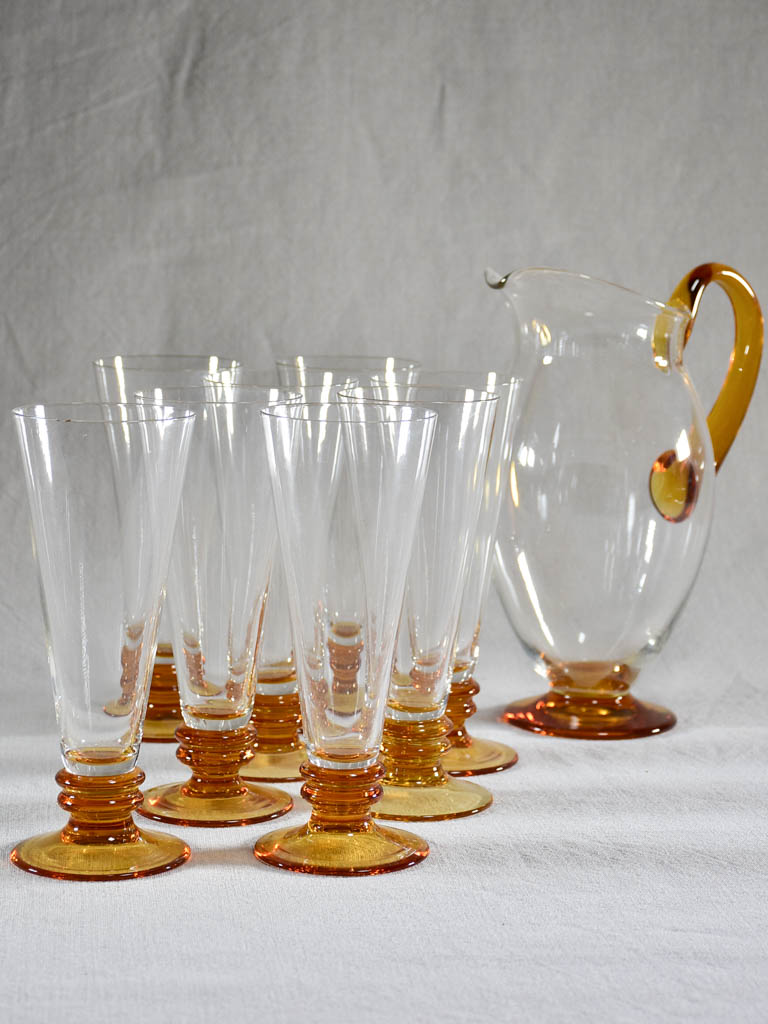 Set of eight tumblers with matching pitcher - clear and amber glass