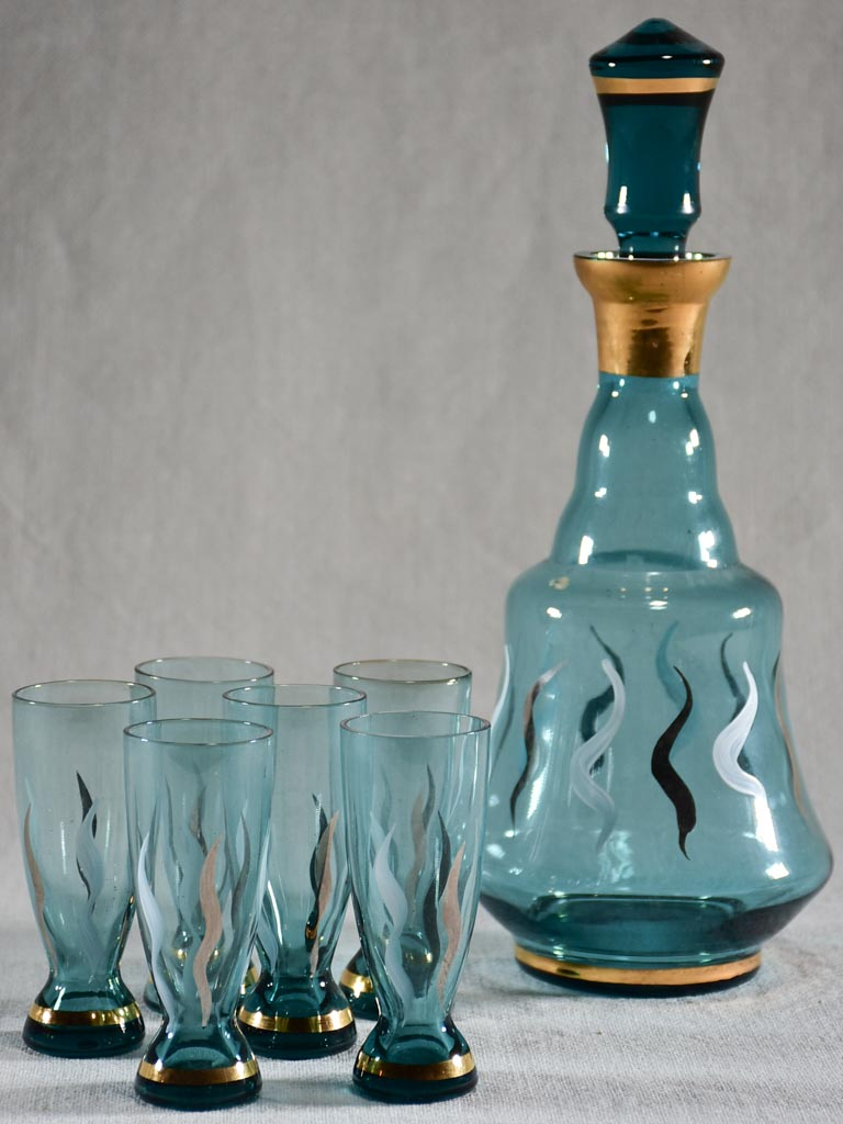 Set of six blue liqueur glasses with matching carafe