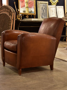 French leather club chair with chapeau gendarme back