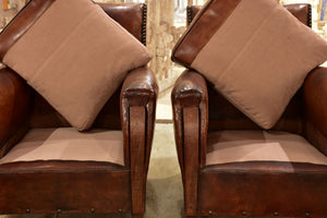 Pair of French leather club chairs from the 1930's with stud detail