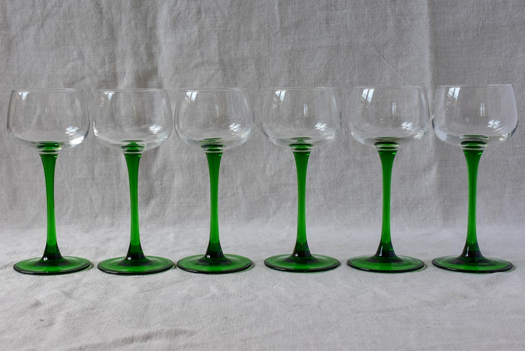 Six vintage Alsatian wine glasses with green stems
