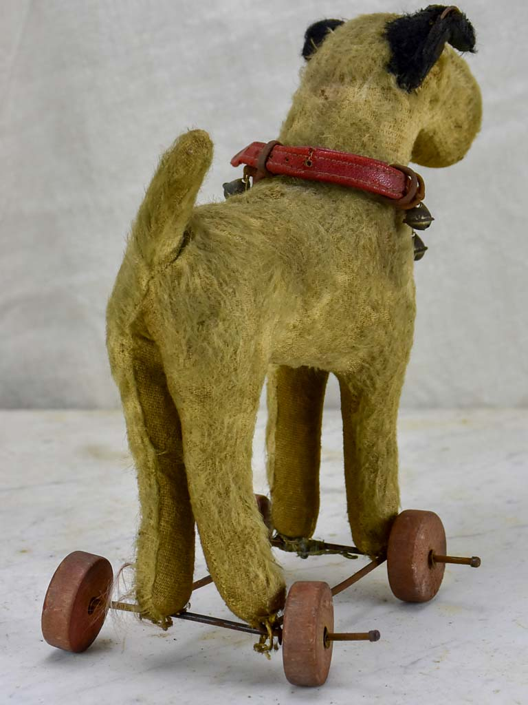 Antique French toy dog on wheels