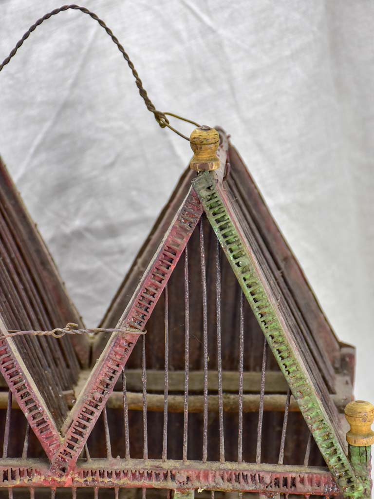 Antique French birdcage with double-pitched roof