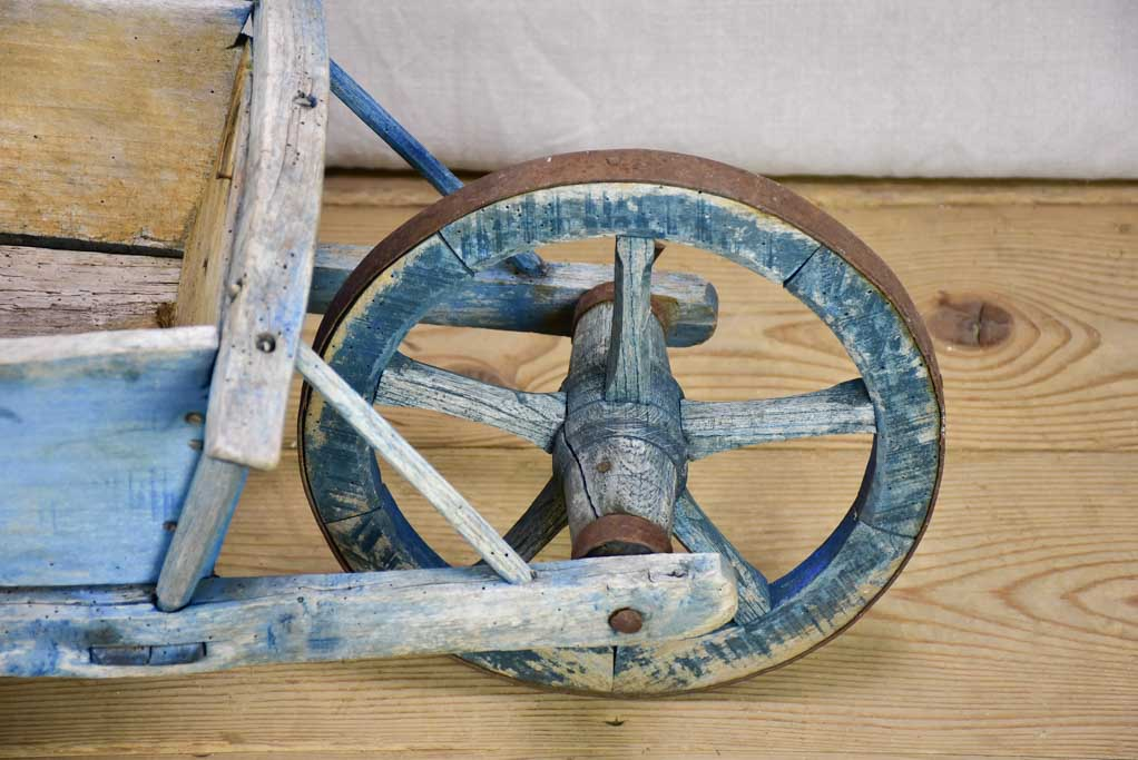 Early 20th Century French children's wheelbarrow with blue patina