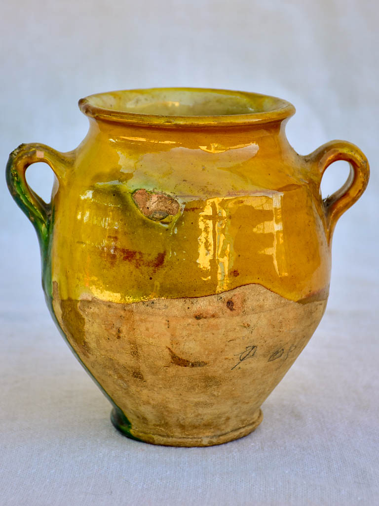 Small 19th Century French confit pot with orange glaze and a green splash 6¼""