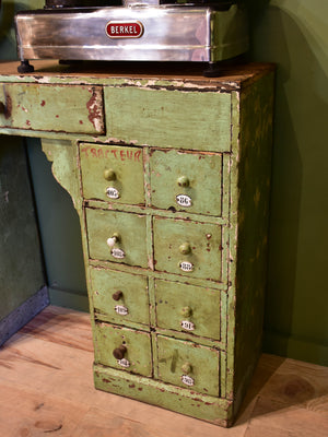 Set of small merchant's drawers with green patina