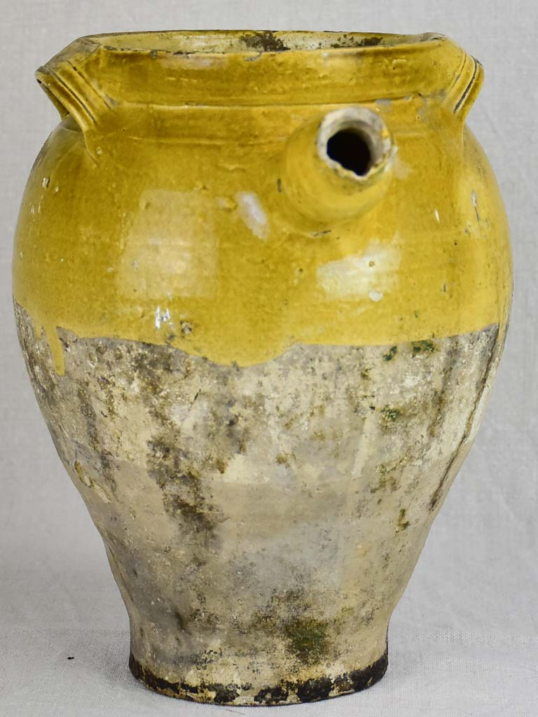 Early 19th Century French cooking clay pot with yellow glaze and handle