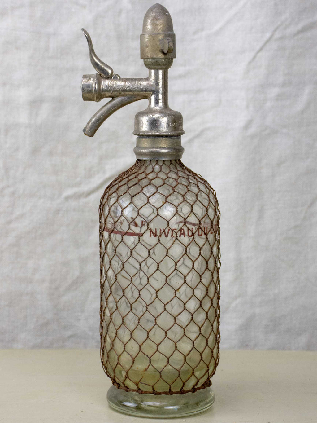 Antique French Sparklets Seltzer bottle with metal wiring