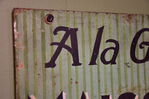 Antique French tailor's sign
