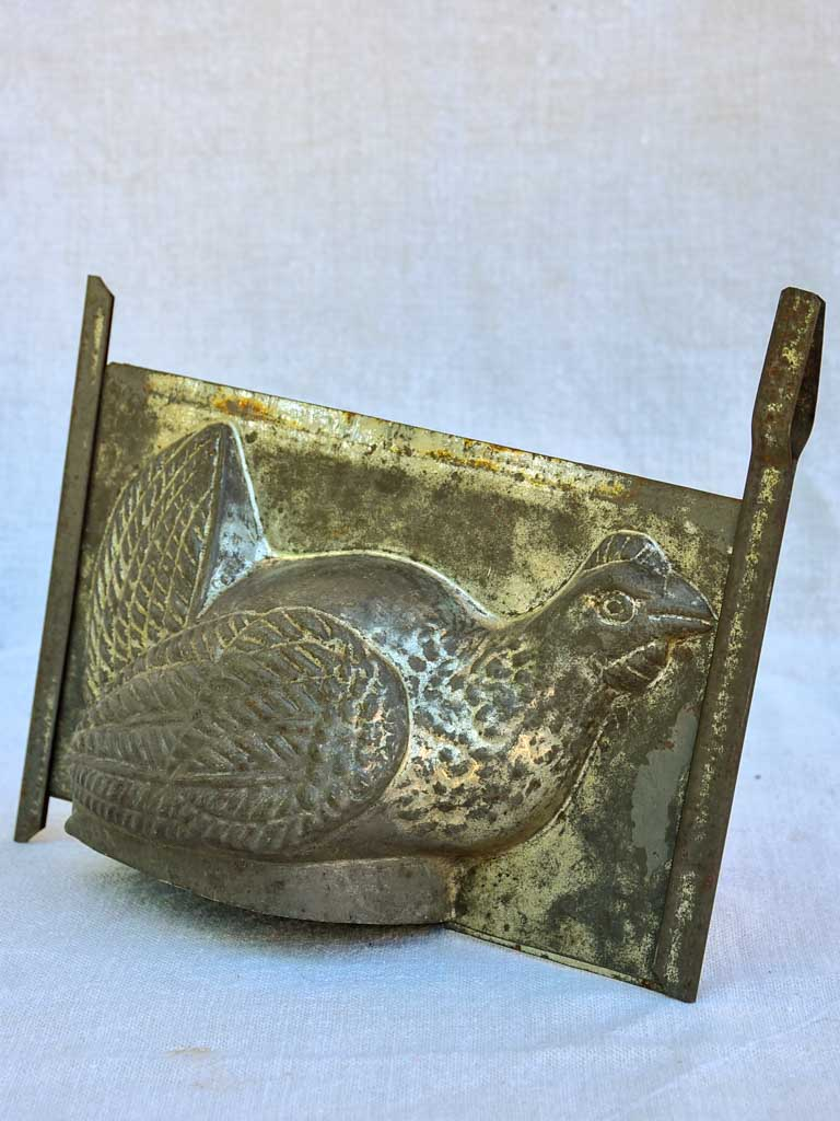 Antique French tin plate chocolate mold in the shape of a chicken