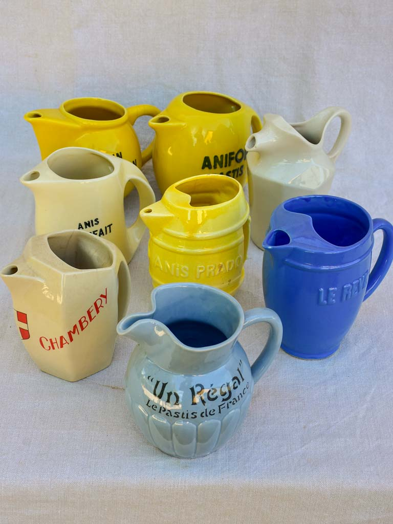 Collection of eight 1930's Pastis water pitchers