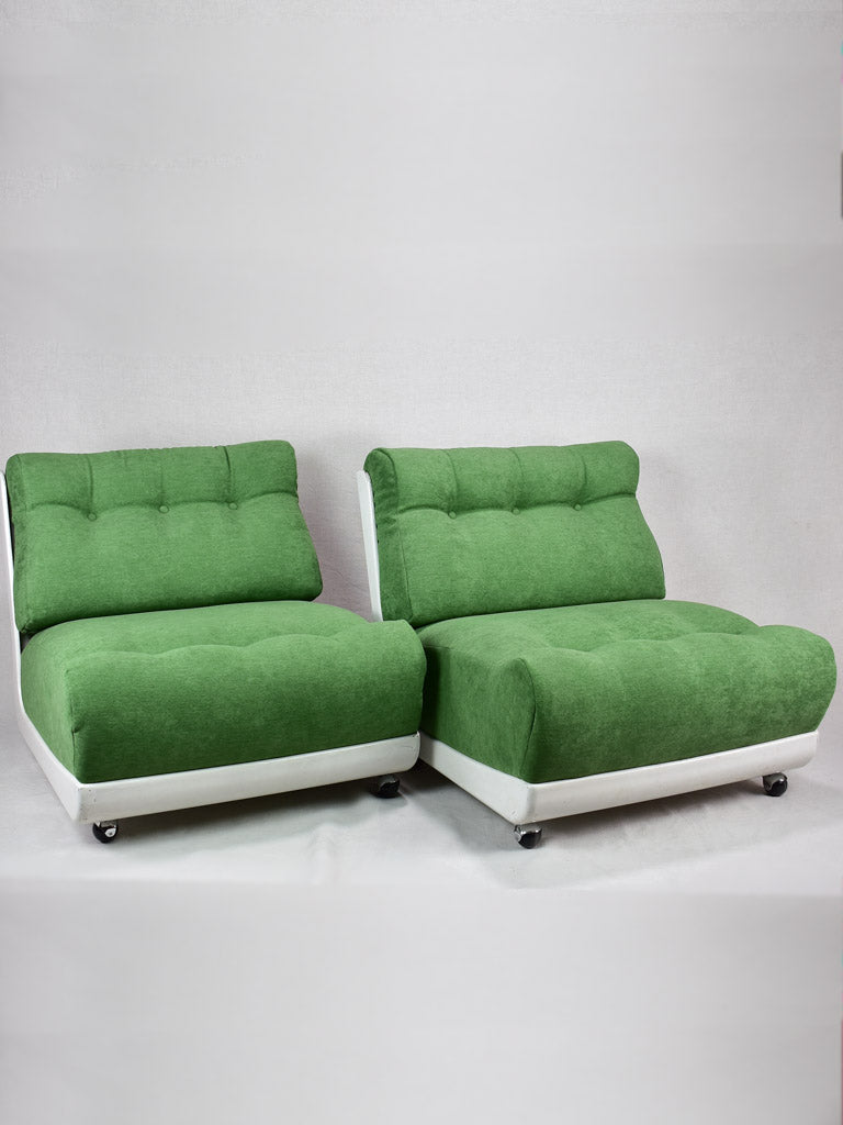 Pair of large vintage lounge chairs with green upholstery