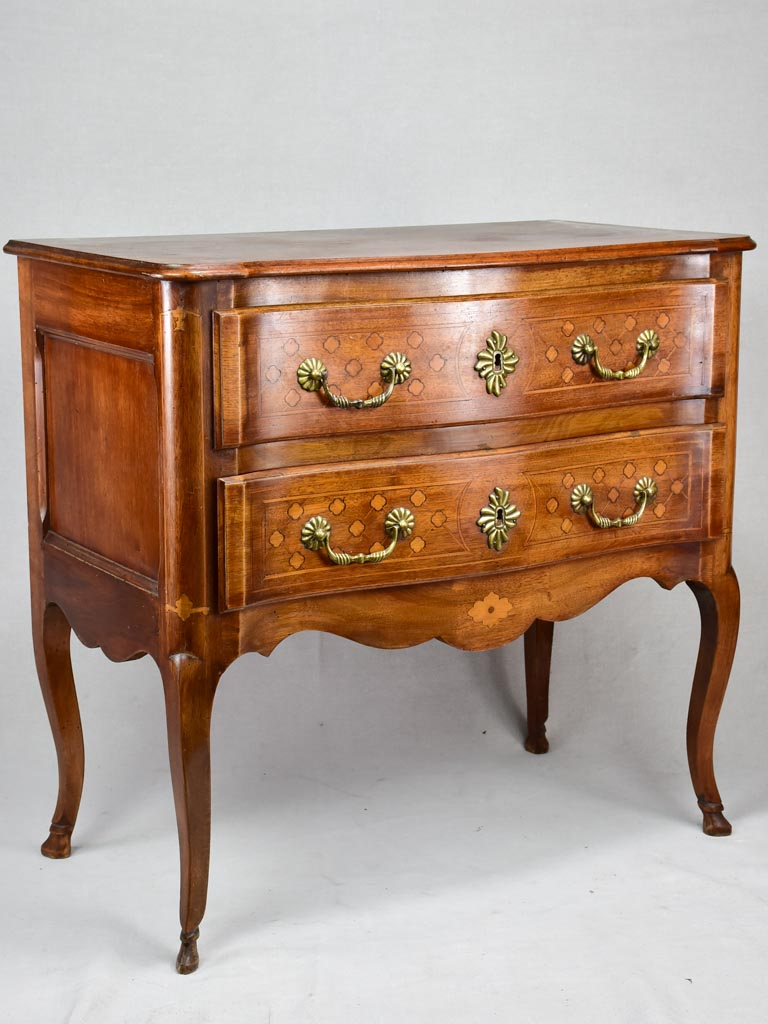 Antique French marquetry sauteuse commode with hoof feet