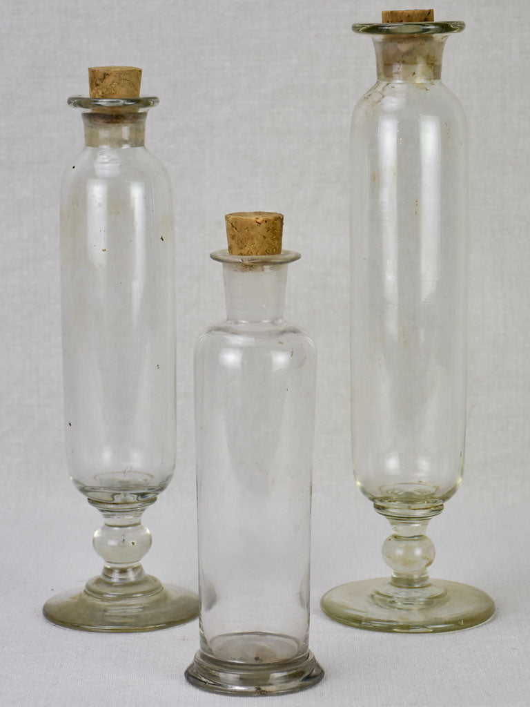 Three blown glass flasks from a pharmacy - 19th century