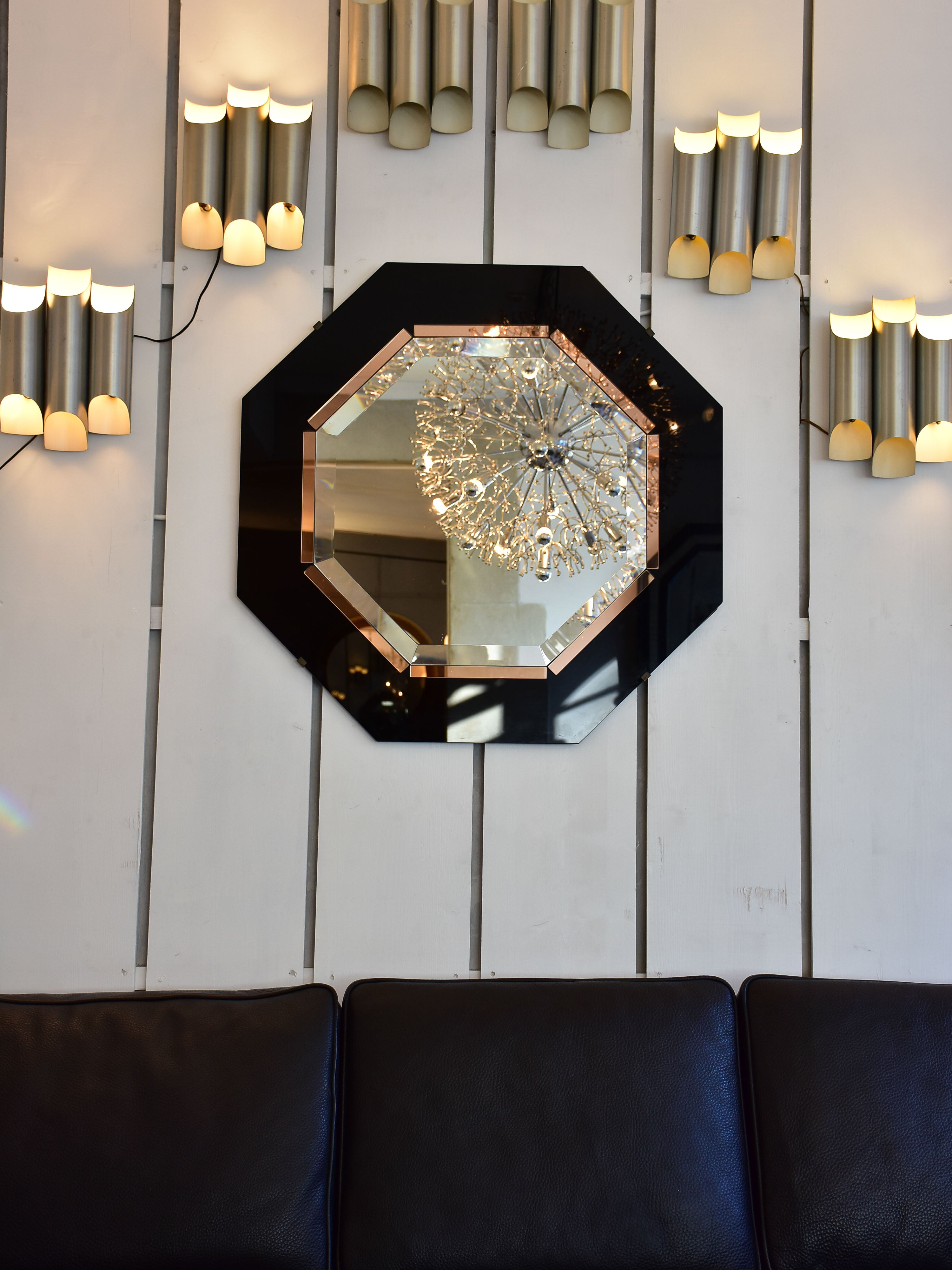 Octagonal mirror with black and pink glass frame